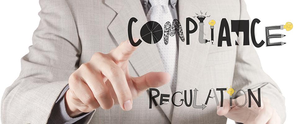 businessman hand pointing to Compliance Regulation designwords a